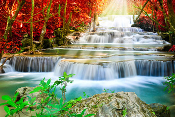 Beautiful waterfall in autumn forest Wall mural