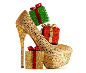 Christmas shopping.Sexy heel with presents