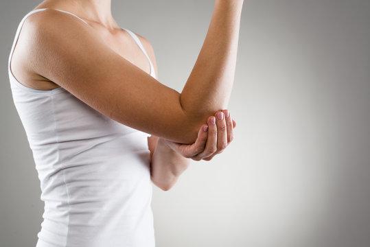 Elbow bone fracture. Female having pain in injured arm.