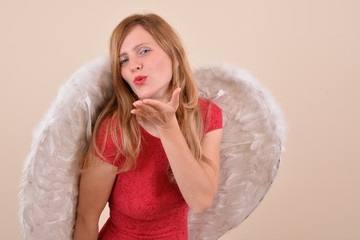 Pretty blonde girl angel, with white wings