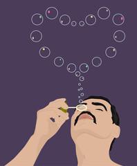 man blowing soap bubbles