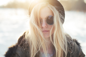 beautiful hipster girl in winter sunny day