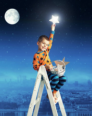 Little boy collecting shining stars