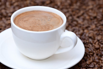 cup of coffee on a coffee beans background