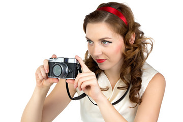 Photo of the photographing woman with retro camera