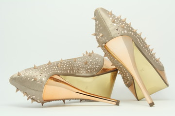 Gold shoes with spikes on 14cm heels.