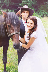 portrait of the newlyweds with a horse