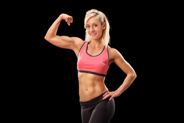 Female bodybuilder showing her bicep
