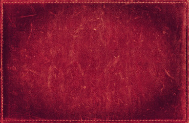 Red grunge background from distress leather texture