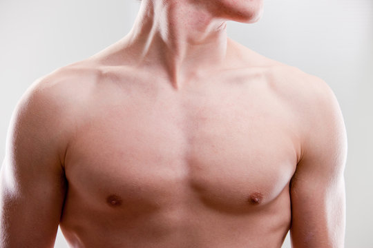 chest and neck of a young strong man