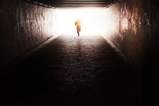 Man running through the tunnel in the sun