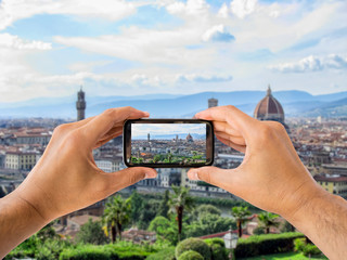 tourist holds up camera mobile at Florence