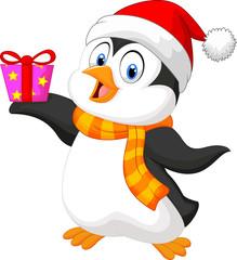 Cute penguin holding present