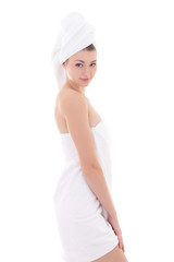 young beautiful slim woman wrapped in towel isolated on white