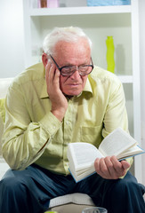 Senior Man Reading a Book