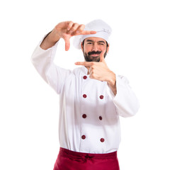 Chef focusing with his fingers on a white background