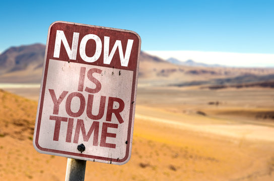 Now Is Your Time sign with a desert background