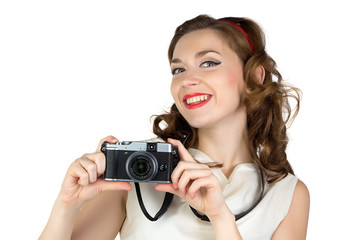 Image of the smiling woman with camera