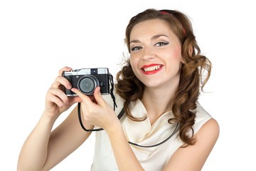 Portrait of the smiling woman with camera