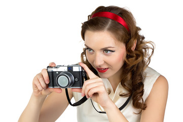 Image of the photographing woman with retro camera