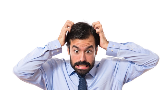frustrated businessman over white background