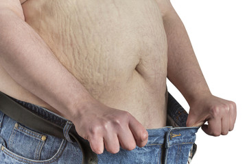 overweight Man stretching blue jeans