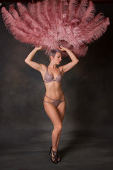 Burlesque dancer holding feather fans up