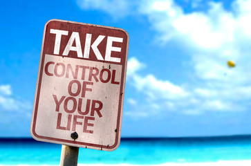 Take Control Of Your Life sign with a beach on background