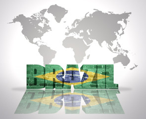 Word Brazil on a world map background