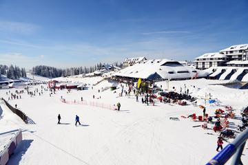 Tourists in mountain ski resort