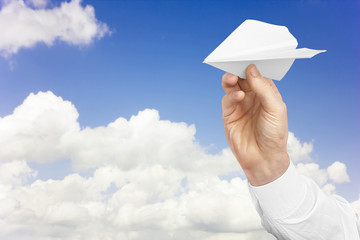 White paper airplane in man's hand