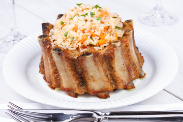 Grilled pork ribs with rice and spices