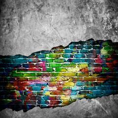 Foto auf AluDibond Graffiti cracked brick wall