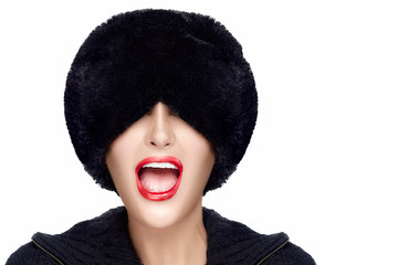Winter Fashion Young Woman in Fur Hat Gesturing and Grimacing