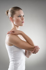 Young woman with injured elbow. Sprain treatment concept