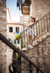 woman walking down stone stairway at ancient town