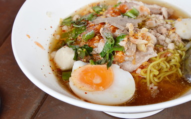 spicy noodle with slice boiled pork and topping boiled egg