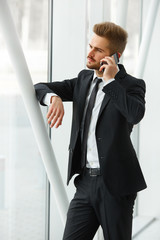 Businessman Talking on the Phone and Smiling