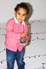 Little boy in a pink shirt.