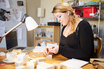 Jeweler Preparing Orders For Dispatch