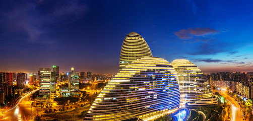 Poster de jardin Pekin cityscape and famous landmark building,WangJing Soho at night.
