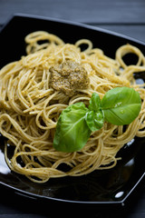 Close-up of spaghetti with basil pesto, studio shot