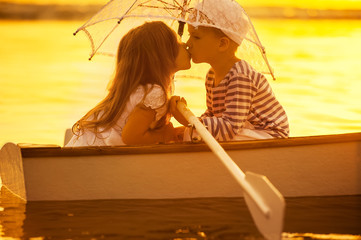 Boy kiss a girl, boating rowed across the lake