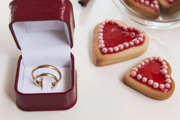 Romantic heart shaped homemade Valentine cookies with wedding ri