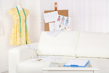 Fashion designer studio with professional equipment, sketches,