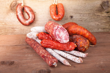 several types of sausages on a wooden background