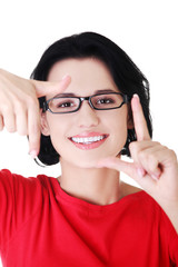 Happy woman creating frame with fingers