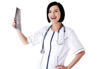 Happy female doctor analysing x-ray image