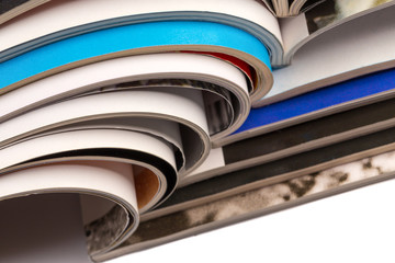 Stack of magazines on white background