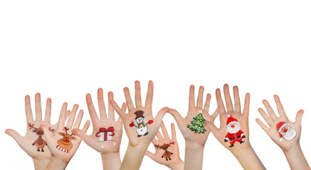 Hands rising up with Christmas symbols. Santa, snowman, reindeer